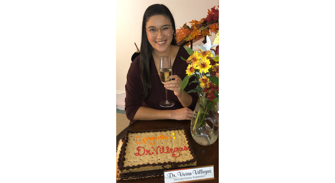 a woman with a glass of wine and cake